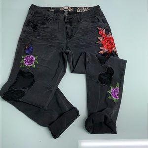 Distressed and embellished black jeans